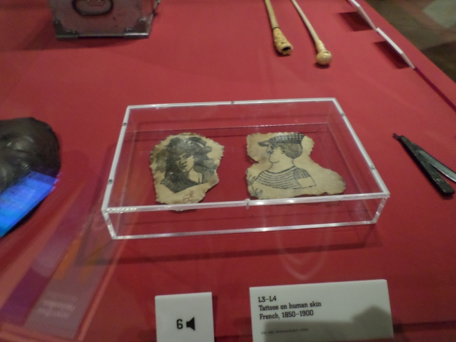 Two pieces of tattooed human skin.