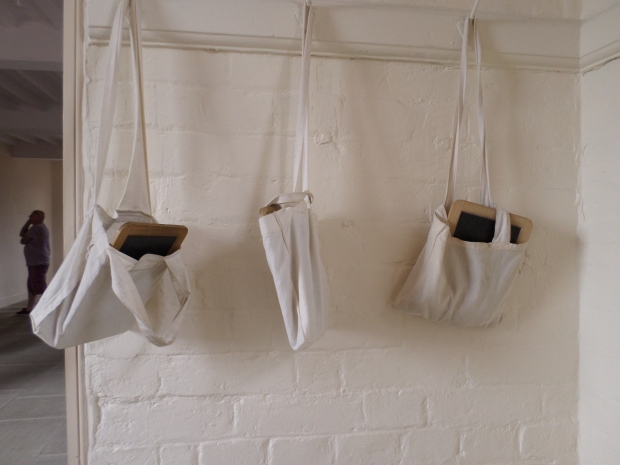 Childrens' slates hanging in the classroom of the workhouse.