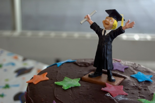 cheering_student_on_graduation_cake_143186839
