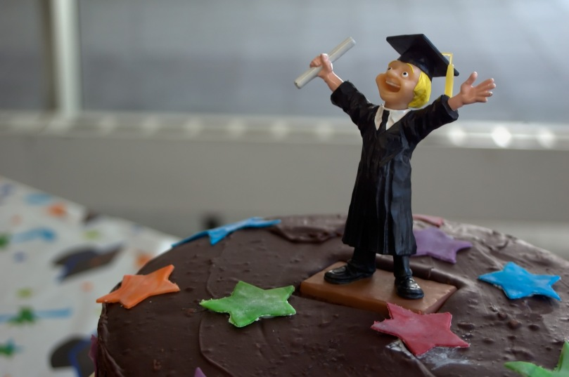 cheering_student_on_graduation_cake_143186839